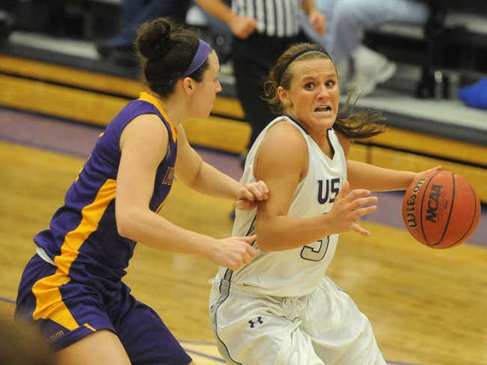 USF's Taylor Varsho looks up toward the basket while MSU Mankato's Alli Hoefer defends at the Stewart Center on Friday, Feb. 21, 2014.