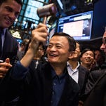 Founder and Executive Chairman of Alibaba Group Jack Ma celebrates as the Alibaba stock goes live during the company's initial price offering (IPO) at the New York Stock Exchange on Friday.