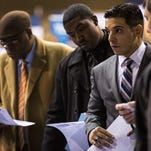 Veterans speak to a job recruiter at a 'Hiring our Heroes' Job Fair on March 27, 2014, in New York City.