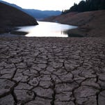 Dry, cracked earth is visible on the banks of Shasta Lake at Bailey Cove on Aug. 31 in Lakehead, Calif.