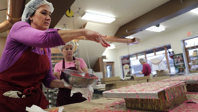 Karen Lenz of Wilmar Chocolates decorates valentine white pretzels at the chocolate shop in Appleton. Other than Christmas, Valentine's Day is the busiest time of the year at the store.