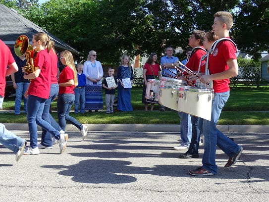 Bucyrus residents line the parade route Monday to thank