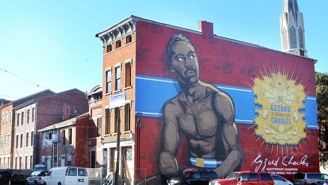 Mural of boxing legend Ezzard Charles on the north face of a building at 1537 Republic St., Over-the-Rhine.