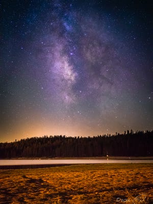 The Milky Way's galactic core shines brightly over Bass Lake, Calif.
