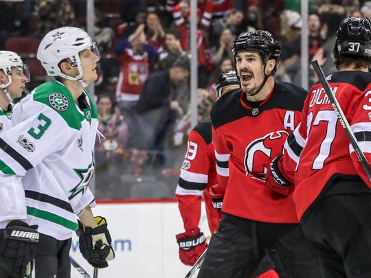 New Jersey Devils center Brian Boyle (11) has words with Dallas Stars defenseman John Klingberg (3) after scoring a goal during the second period at Prudential Center.