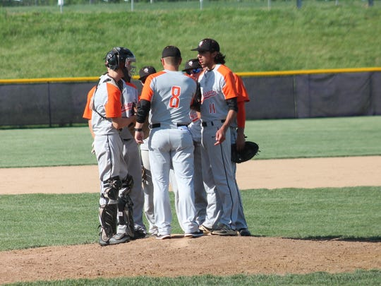 Anderson coach Drew Schmidt (8) consults with his pitcher and infield vs. Elder May 10.