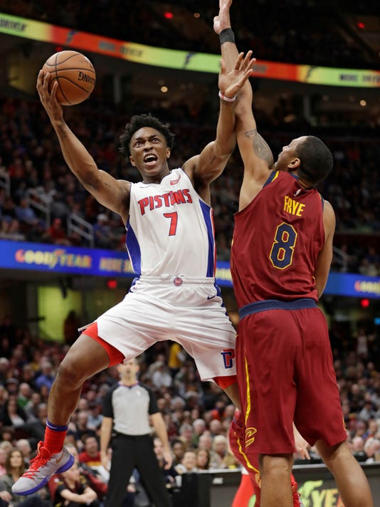 Detroit Pistons' Stanley Johnson (7) drives to the basket against Cleveland Cavaliers' Channing Frye (8) in the second half of an NBA basketball game, Sunday, Jan. 28, 2018, in Cleveland. The Cavaliers won 121-104. (AP Photo/Tony Dejak)