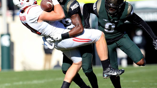 Michigan State University freshman receiver Donnie Corley (29) with a big tackle on Rutgers tight end Matt Flanagan (81) during the first half of the MSU vs. Rutgers Big Ten football game at  Spartan Stadium Saturday, Nov. 12, 2016 in East Lansing.