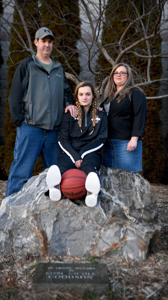 Chesney Gardner sits with her parents, Matt and Monica,