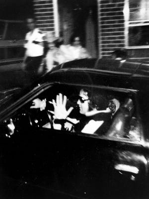 A fan photo provided to The Commercial Appeal shows Elvis driving through the gates of Graceland in his Stutz Blackhawk the morning of Aug. 16, 1977. Later that day the King died.