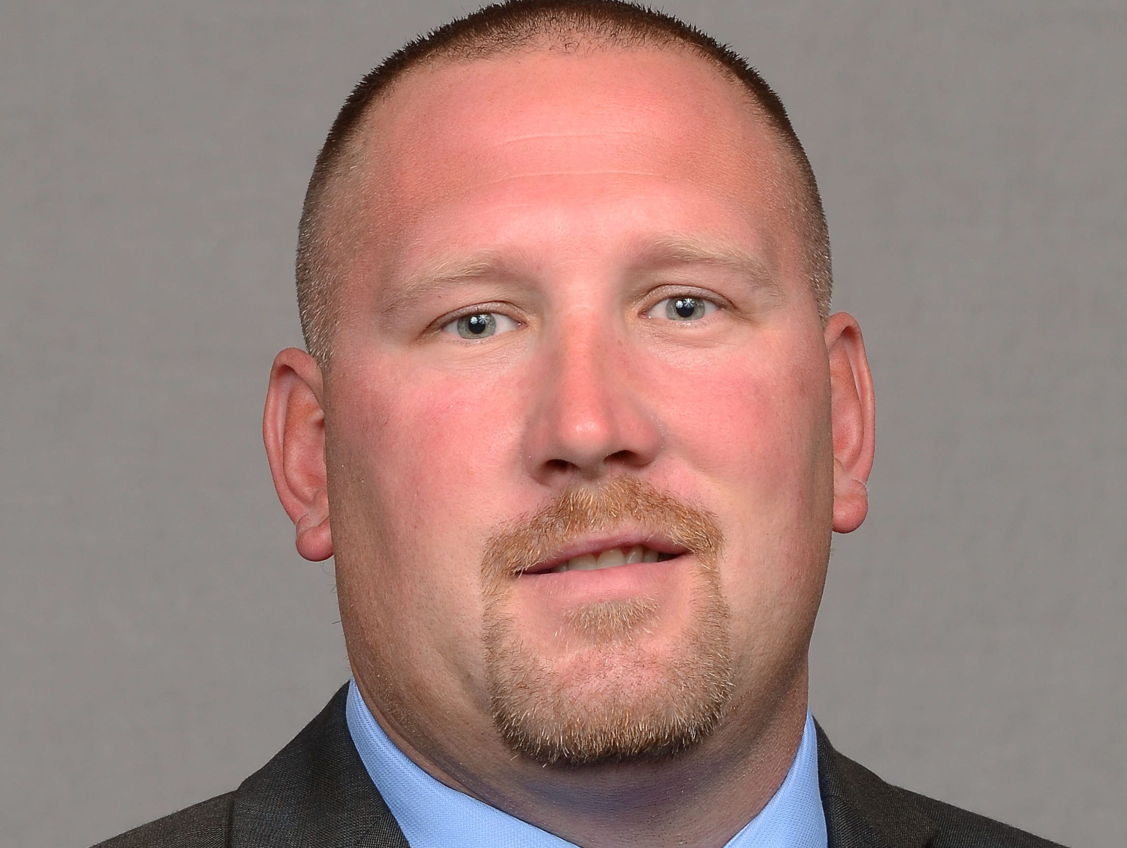 Tim Polasek will become Iowa's offensive line coach.