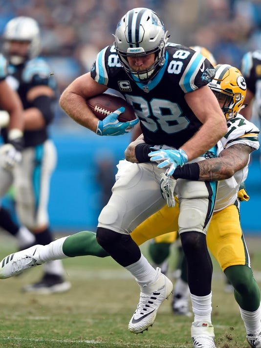 Carolina Panthers' Greg Olsen (88) is tackled by Green Bay Packers' Josh Jones (27) during the second half of an NFL football game in Charlotte, N.C., Sunday, Dec. 17, 2017. (AP Photo/Mike McCarn)