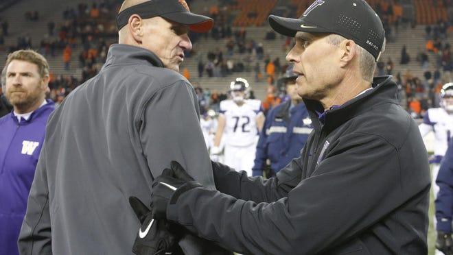 Oregon State coach Gary Andersen, left, and Washington coach Chris Petersen meet after an NCAA college football game in Corvallis, Ore., Saturday, Nov. 21, 2015. Washington won 52-7. (AP Photo/Timothy J. Gonzalez)