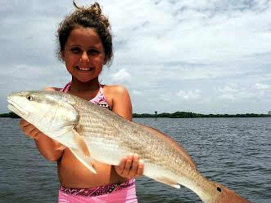 Faith Richards' 29-inch redfish wasn't too much shorter than the angler. She caught it on a live pinfish near Estero Bay's Starvation Key, with Get Hooked Charters Capt. Matt DeAngelis.