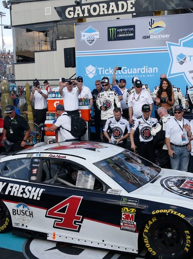 Kevin Harvick celebrates winning the Ticket Guardian 500 at ISM Raceway on March 11, 2018 in Avondale, Ariz.