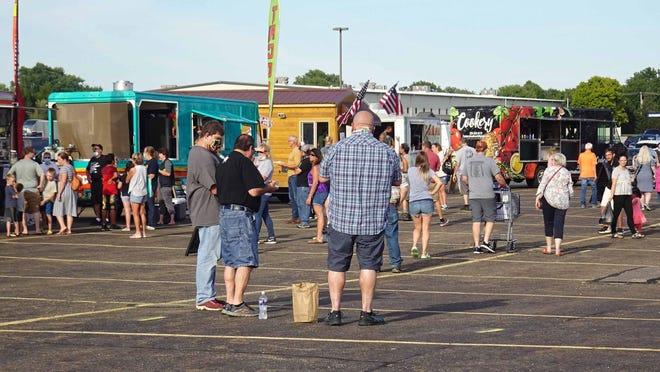 There were 11 area food trucks lined up in the parking lot of the Hartville Marketplace for the Moonlight Market on Aug. 21. There were a variety of foods offered including grilled sweetcorn from Grosenbaugh Farm.