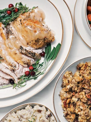 """With a bit of strategizing, a full turkey dinner with all the trimmings can be prepared in a kitchen with just one oven. This spread is from """"Holiday Slow Cooker"""" by Leigh Anne Wilkes."""