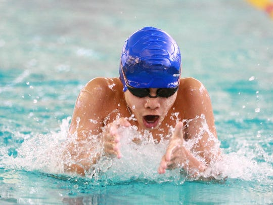 Joaquin Pinga of the EDGE Swim Club swims breaststroke during the 100-yard IM at the Vermont Swim Association state championships meet on Saturday at the Upper Valley Aquatic Center in White River Junction.