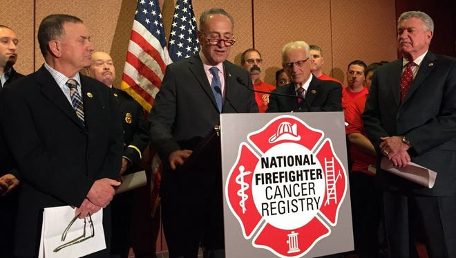 Sen. Chuck Schumer, D-N.Y., (center) participates in a press conference on Tuesday, May 17, 2016 about legislation to create a National Firefighter Cancer Registry. He was joined by Rep. Richard Hanna, R-N.Y., (left) Rep. Bill Pascrell, D-N.J., (right) and Harold Schaitberger, president of the International Association of Fire Fighters (far right).
