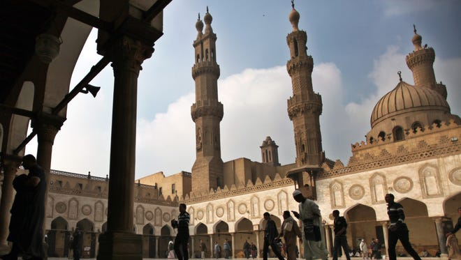 """FILE - In this Friday, Dec. 28, 2012 file photo, Muslims arrive to attend the Friday prayer at Al-Azhar mosque in Cairo, Egypt. Dar el-Ifta, the top Islamic authority in Egypt, revered by many Muslims worldwide, launched Sunday an internet-based campaign aimed particularly at the West against an extremist group in Syria and Iraq, saying it is not an """"Islamic State."""" The Grand Mufti of Egypt, Shawki Allam, and clerics from the oldest Islamic learning institute, Al-Azhar, have condemned the Islamic State saying it was violating all Islamic principles and laws, describing it as a danger to the religion."""