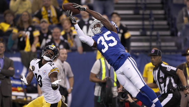Pierre Desir  intercepts the ball  in the first half of the Colts' game Nov. 12 against the Pittsburgh Steelers. Yjr Steelers' Martavis Bryant (10) can only watch.
