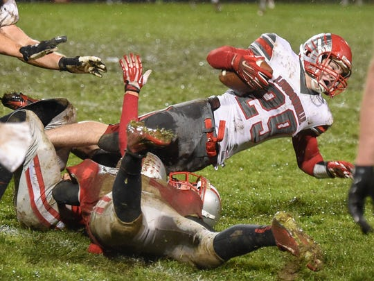 "Loudonville""s Jordan Wright goes down after gaining some tough yardage against Shelby in Friday night action at Shelby."