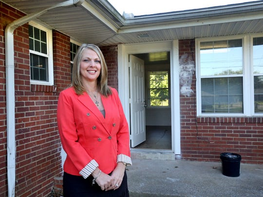 Lisa Terry, CEO of the Hope Clinic, stands in front of the new location of the clinic in Mercury Court, which is still undergoing renovations.