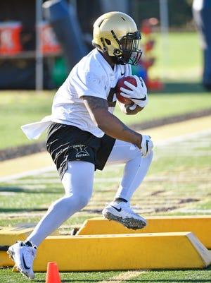 Running back Ke'Shawn Vaughn goes through drills during Vanderbilt's first practice of spring on Monday.