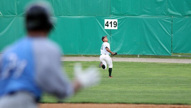 Mountaineer centerfielder Laren Eustace retreats towards the fench to grab a fly ball against the Mystic Schooners in Game 2 of the NECBL championship series Monday night.