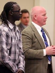 Peterpal Tutlam, left, stands with attorney David Harris,