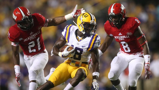 LSU's Tre'Davious White (18) returns a punt against Jacksonville State on Saturday.