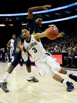 Jajuan Johnson and Marquette will have to defend much better if the Golden Eagles want to upset No. 2 Villanova on Tuesday.