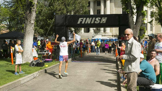 Ron Rodriguez of Gilbert approaches the finish line at the Whiskey Row Marathon in Prescott.