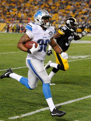 Lions rookie running back Dwayne Washington on his way down the sidelines to a 96-yard kick return for a touchdown in the fourth quarter.