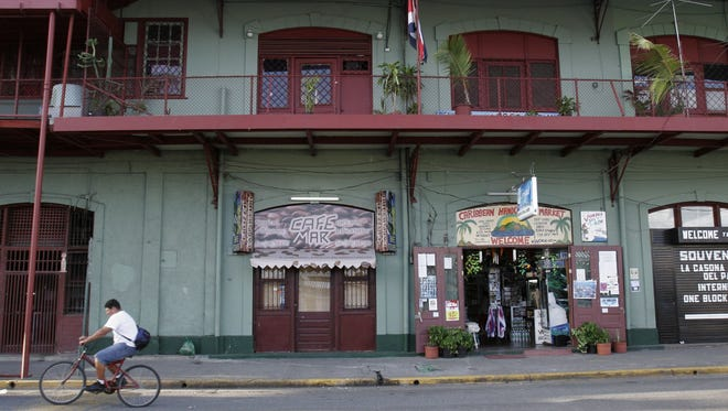 A Costa Rican man rides through souvenir shops in the Caribbean port city of Limon, Costa Rica.