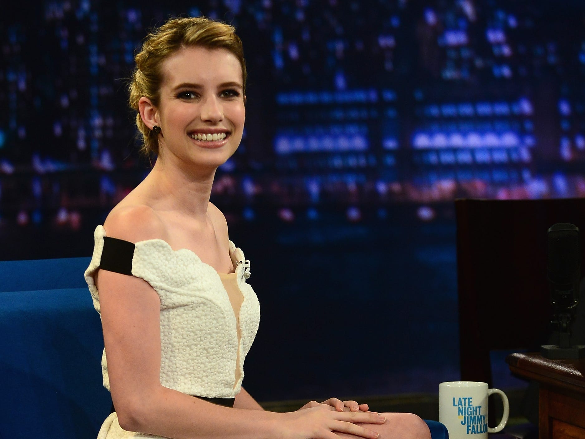 What's black and white and chic all over? Plenty of celebs these days. USA TODAY's Arienne Thompson rounds up the latest crop of stars making their marks in the classic color combo. | Actress  Emma Roberts is sitting pretty in a Three Floor dress and Jimmy Choo heels for her visit to 'Late Night With Jimmy Fallon' on Aug. 8.