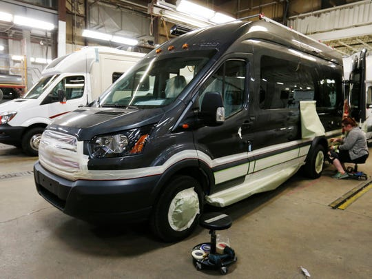 Workers prepare a Winnebago Paseo, a van-style motorhome, for painting Wednesday, Nov. 16, 2016, at the Winnebago manufacturing plant in Forest City, Iowa.