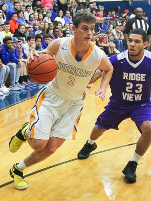 Wren wing Isaac Ford dribbles around Ridge View forward Josiah Coatie (23) during the second quarter on Tuesday at Wren High School in Piedmont. Wren won 75-65.