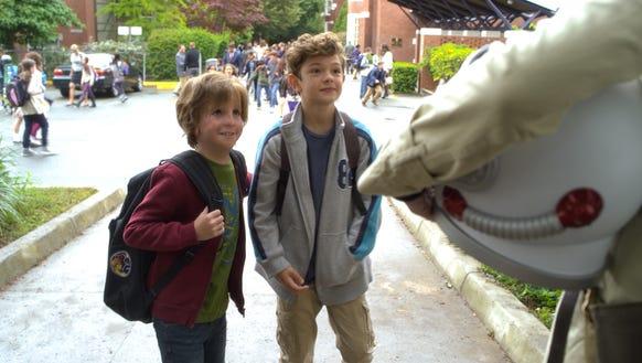 In 'Wonder,' Auggie (Jacob Tremblay, left) makes his