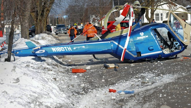 An experimental helicopter had to make an emergency landing in a residential area of Menominee, Mich., on Friday.