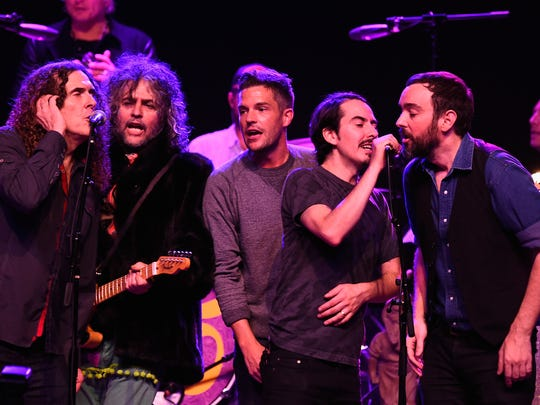 """Weird Al"" Yankovic (left) is joined by Wayne Coyne of The Flaming Lips, Brandon Flowers of The Killers, Dhani Harrison and Jonathan Bates at ""George Fest: An Evening To Celebrate the Music of George Harrison"" at The Fonda Theatre in Los Angeles in 2014."