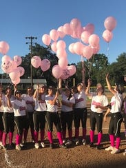 Shasta High softball players release balloons during