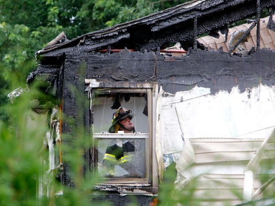 New Rochelle firefighters battled a house fire at 35 Northwood Circle, July 19, 2014 in New Rochelle.