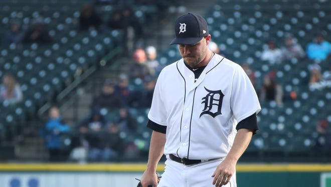Detroit Tigers relief pitcher Alex Wilson leaves the field after giving up a three run homer in the 13th inning as the Detroit Tigers take on the Pittsburgh Pirates at Comerica Park for Opening Day in Detroit Friday March 30, 2018.