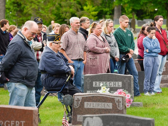 The names of veterans are read during a Memorial Day