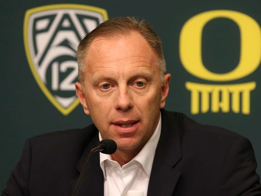 FILE - In this Nov. 29, 2016, file photo, Oregon athletic director Rob Mullens talks to the media in Eugene, Ore., after the firing NCAA college football head coach Mark Helfrich. Mullens will become the new chairman of the College Football Playoff selection committee starting next season, and three new Power Five ADs will join the 13-member panel. (Chris Pietsch/The Register-Guard via AP, File)