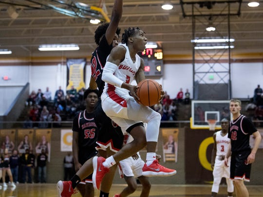 Bosse's Mekhi Lairy (2) drives and shoots against Harrison's Isaiah Edinburgh (22) during the SIAC Championship game at Central High School Saturday night. Bosse beat Harrison 106-63.