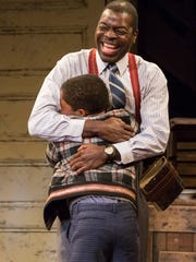 """Chiké Johnson (top) and Lex Lumpkin perform in Indiana Repertory Theatre's """"A Raisin in the Sun."""""""