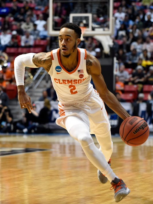 Clemson guard Marcquise Reed (2) moves the ball upcourt during the first half of a first-round NCAA college basketball tournament game against New Mexico State, Friday, March 16, 2018, in San Diego. (AP Photo/Denis Poroy)