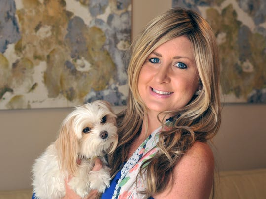 Lindsay Farlow of Melbourne, seen here with her dog